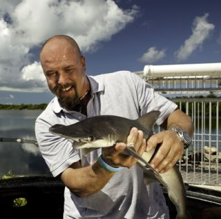 SharkDefense researcher Patrick Rice with a bonnethead shark at the Aquaranch facility in Long Key, Florida. Bonnethead sharks were used to perform the initial tests on the shark repellent hook.