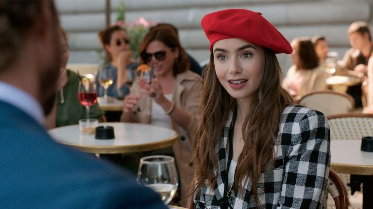 """""""Emily In Paris"""" (L To R) Lily Collins As Emily In Episode 103 Of """"Emily In Paris"""". Credit: Netflix/The Hollywood Archive"""