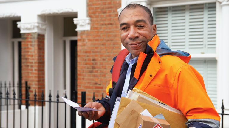postal worker with parcel