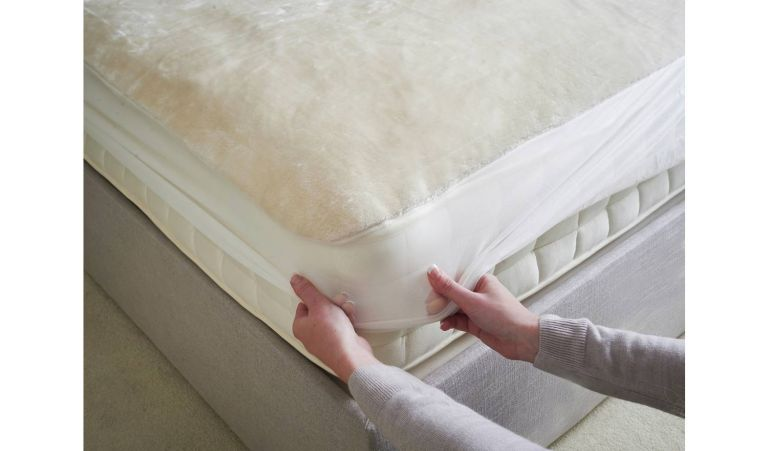 This mattress protector is furry, heated, cheap as chips to run and machine washable. We want!