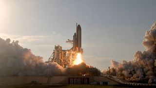 ace shuttle Discovery lifts off.