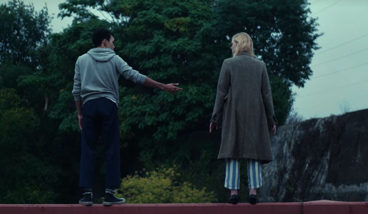 Justice Smith and Elle Fanning on bridge in All the bright Places
