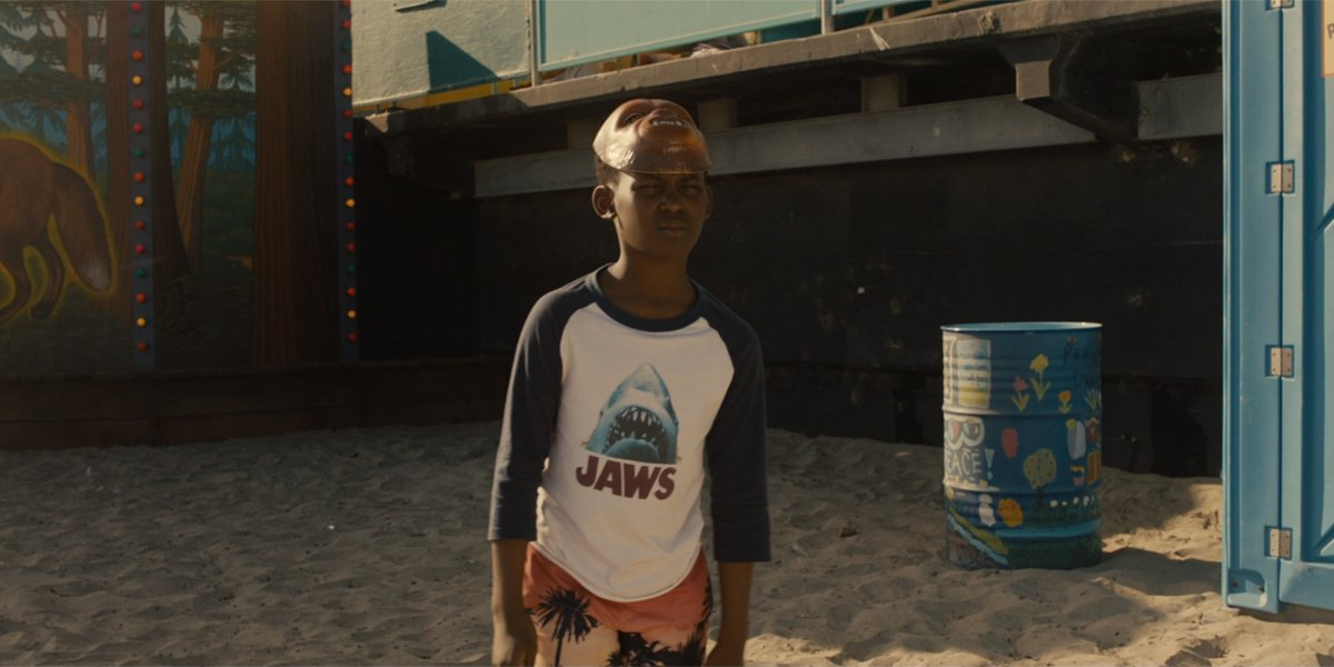 Jason wearing Jaws shirt in Us