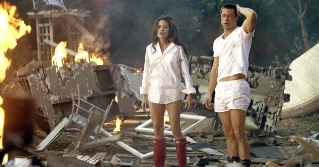 Married assassins Mr. and Mrs. Smith (Brad Pitt, Angelina Jolie) react to the smoldering remnants of what was once their home. Photo Credit: Stephen Vaughn / SMPSP                                       TM and © 2005 by Regency Entertainment (USA), Inc. and Monarchy Enterprises S.a.r.l. Not for sale or duplication.