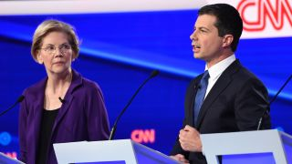 Democratic presidential hopeful Massachusetts Senator Elizabeth Warren (L) looks on as Mayor of South Bend, Indiana Pete Buttigieg speaks during the fourth Democratic primary debate of the 2020 presidential campaign season co-hosted by The New York Times and CNN at Otterbein University in Westerville, Ohio on October 15, 2019.