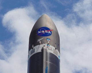 A Rocket Lab Electron booster is decked out with a big NASA logo ahead of the company's first launch for the U.S. space agency from its New Zealand launch site, on the North Island's Mahia Peninsula. Liftoff is scheduled for Dec. 12, 2018.