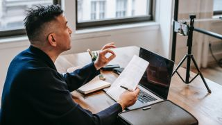 Man Studying Online at Home