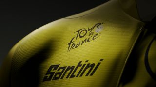 A cryptic close up of a yellow jersey with both the Tour de France and Santini logos visible