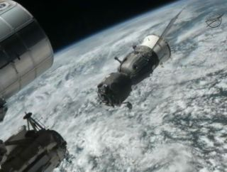 The Russian Soyuz TMA-03M backs away from the International Space Station after undocking on July 1, 2012.