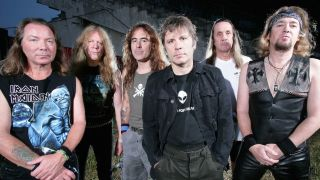 Iron Maiden standing together in a row.