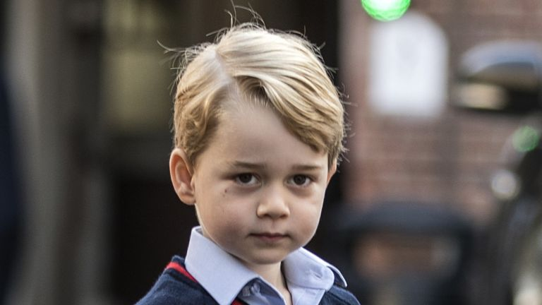 TOPSHOT - Britain's Prince George arrives for his first day of school at Thomas's school in Battersea, southwest London on September 7, 2017. / AFP PHOTO / POOL / RICHARD POHLE (Photo credit should read RICHARD POHLE/AFP via Getty Images)