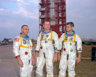 Apollo 1 astronauts (left to right) Gus Grissom, Ed White, and Roger Chaffee posing in front of Launch Complex 34 at Cape Canaveral Air Force Station in Florida. All three were killed when a fire blazed up in their capsule during a ground test on Jan. 27,