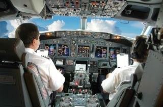 Pilots in airplane cockpit. Politeness is dangerous in high stakes situations, such when a pilot is trying to fly a plane in an emergency.