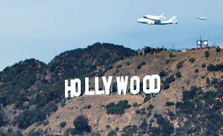 Photographer Olivia Hemaratanatorn captured this view of space shuttle Endeavour soaring over the famed Hollywood sign during its low flyover of Los Angeles on Sept. 21, 2012.