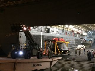 NASA's Orion capsule is offloaded from the USS Anchorage on Dec. 8, 2014. The U.S. Navy ship retrieved Orion from the Pacific Ocean after its historic first test flight on Dec. 5.