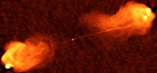 This radio image shows two jets shooting out of the center of Cygnus A, a galaxy not too far from our own. A new paper reports discovering a similar object in a much more distant, ancient galaxy. That galaxy has a bright, relatavistic jet emanating from its central supermassive black hole pointed at Earth, making it a blazar.