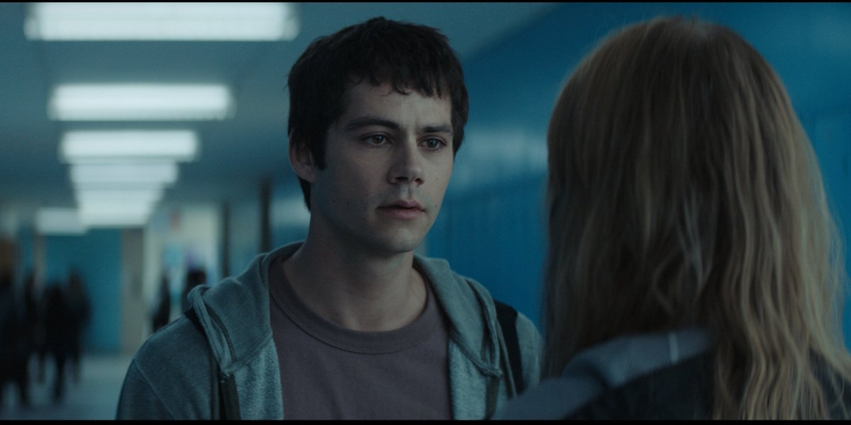 Dylan O'Brien as Fred in Flashback, appearing exhausted and concerned