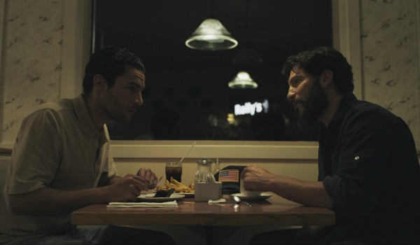 Jon Bernthal and Christopher Abbott sharing a meal in Sweet Virginia
