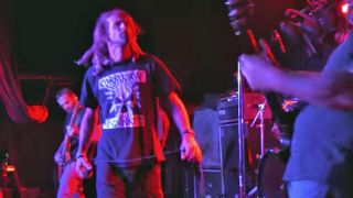A picture of Randy Blythe onstage with Eyehategod