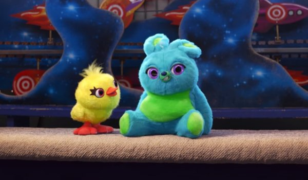 Toy Story 4 Ducky and Bunny sitting at their carnival game