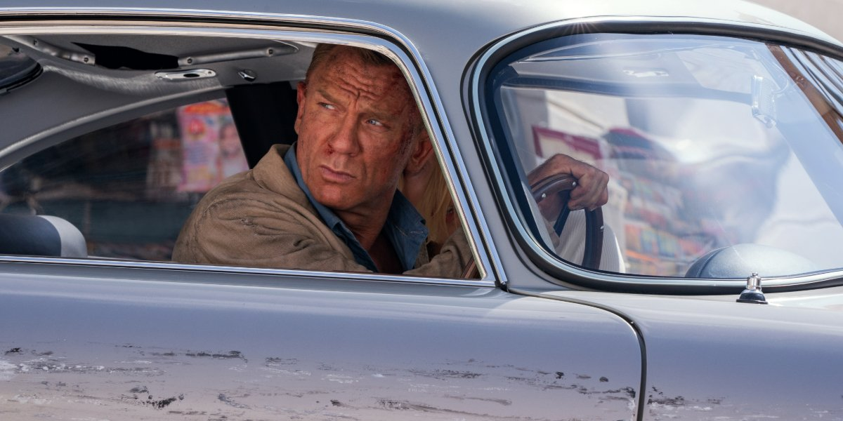 No Time To Die James Bond glares out of his car's window