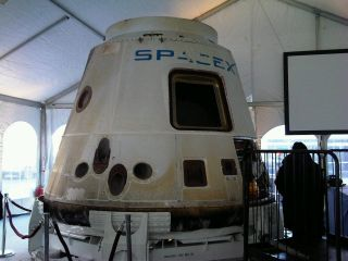 SpaceX showcased the company's flown Dragon space capsule at an event jointly hosted with Tesla Motors in Washington, D.C. on Feb. 10, 2011.