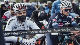 Nino Schurter waiting on the start line of a cross country race whilst wearing some of the best XC helmets