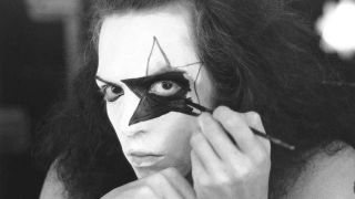 Paul Stanley of Kiss applying make-up