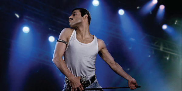 Rami Malek on stage as Freddie Mercury in Bohemian Rhapsody