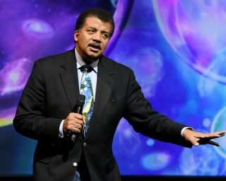 Astrophysicist Neil deGrasse Tyson speaks on stage during the Onward18 Conference in New York City on Oct. 23, 2018.