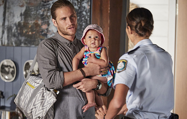 Ash Ashford questions Kat Chapman on why she is avoiding the adoption process with baby Luc in Home And Away.