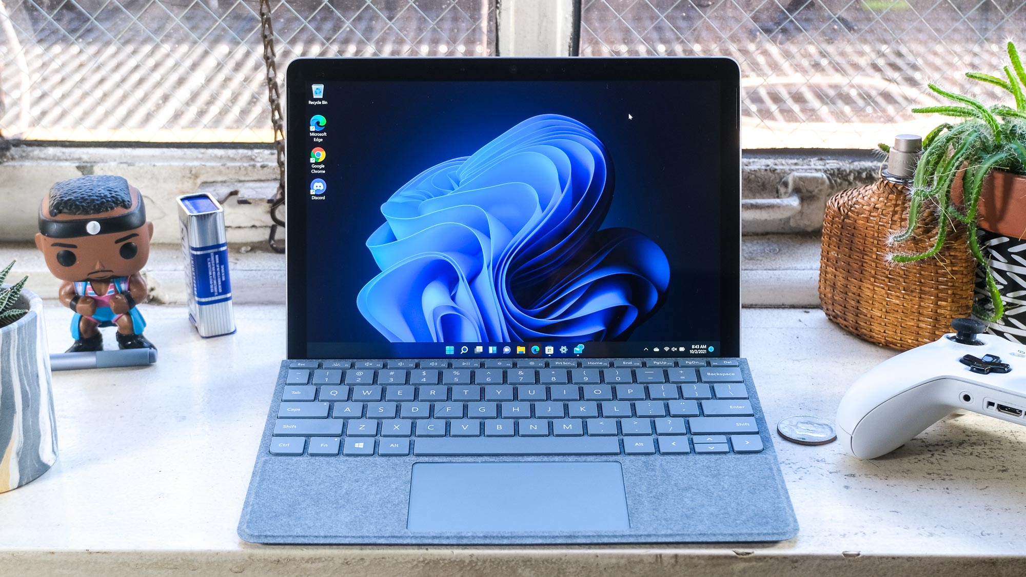 Microsoft Surface Go 3 on a window sill