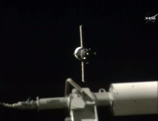 The Russian unmanned cargo ship Progress 64 approaches the International Space Station ahead of docking on July 18, 2016.