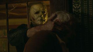 Michael Myers strangles a woman in Halloween Kills
