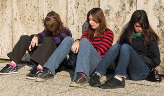 sad-teens-sitting-110315-02
