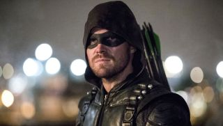 Stephen Amell looking intense dressed up as Arrow.