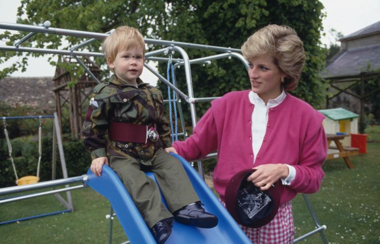 Princess Diana with Prince Harry wearing the uniform of the Parachute Regiment of the British Army in the garden of Highgrove House in Gloucestershire, 18th July 1986