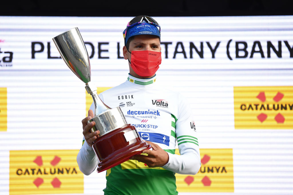 PLA DE LESTANY BANYOLES SPAIN MARCH 23 Podium Joo Almeida of Portugal and Team Deceuninck QuickStep Green Leader Jersey Celebration during the 100th Volta Ciclista a Catalunya 2021 Stage 2 a 185km Individual Time Trial stage from Pla de LEstany Banyoles to Pla de LEstany Banyoles 145m ITT Trophy Mask Covid Safety Measures VoltaCatalunya100 on March 23 2021 in Pla de LEstany Banyoles Spain Photo by David RamosGetty Images