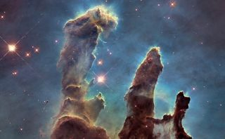 """These towers of cosmic dust and gas make up part of the Eagle Nebula, also called the """"pillars of creation."""""""