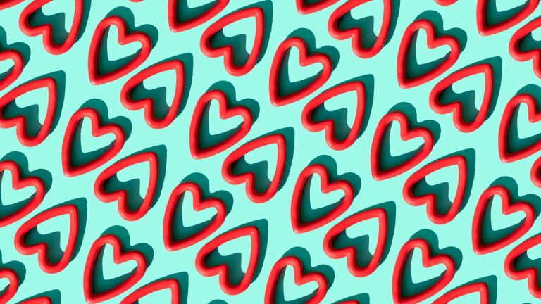 Repeated red heart shapes on the turquoise background