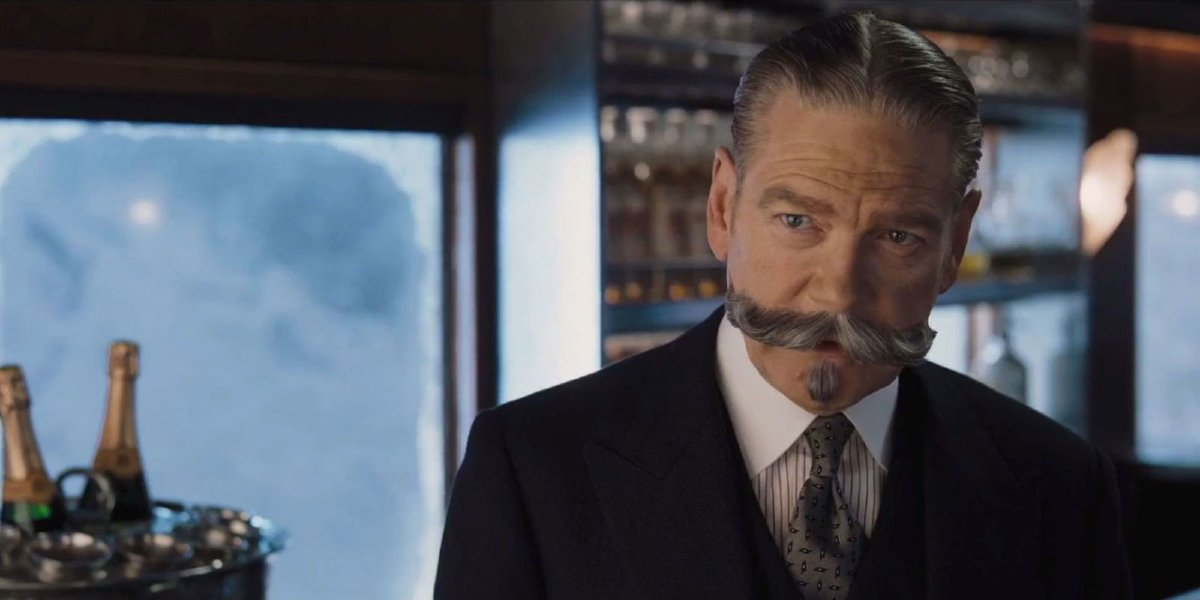 Murder on the Orient Express Poirot speaking in the bar car