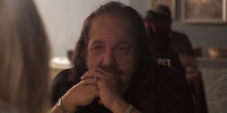 Am I Doing This Right Ron Jeremy sitting at a table