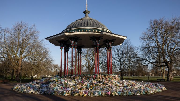Flowers surround the Clapham Common bandstand memorial to murdered Sarah Everard on March 27, 2021 in London
