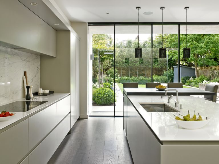 open plan kitchen diner with large bifold doors by brayer design
