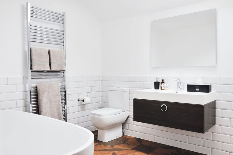monochrome bathroom with statement flooring