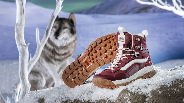 Vans UltraRange EXO MTE-3 hiking boots on some fake snow in a magical looking landscape with a wolf in the background