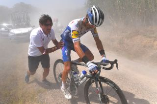 SIENA ITALY AUGUST 01 Davide Bramati of Italy Sports Director of Deceuninck QuickStep Julian Alaphilippe of France and Team Deceuninck QuickStep Mechanical Problem during the Eroica 14th Strade Bianche 2020 Men a 184km race from Siena to SienaPiazza del Campo StradeBianche on August 01 2020 in Siena Italy Photo by Tim de WaeleGetty Images