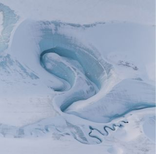 Meltwater channels are carved into DeVries Glacier in the Canadian Arctic. This aerial image was captured on March 29, 2017.