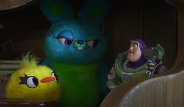 Toy Story 4 Ducky and Bunny look at Buzz Lightyear with a knowing smirk