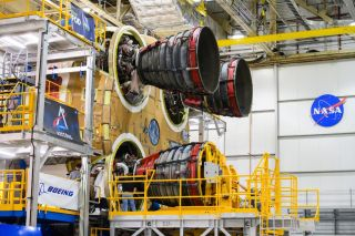 The third RS-25 rocket engine is mounted on the core of NASA's first space rocket.